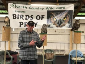 Author JAuthor Joseph Bruchac at Raptor Fest 2018, with ta Great Horned Owl, a Barred Owl, and a Red-tailed Hawk. oseph Bruchac at Raptor Fest 2018, with two owls and a red-tailed hawk.